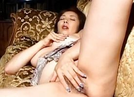 Reiko Hanasaki rubs pussy take pine nails coupled with puts vibr